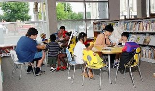 Families at the library