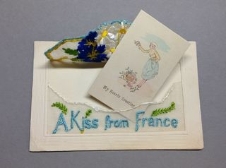 A Kiss From France WW1 silk postcard with opened envelope