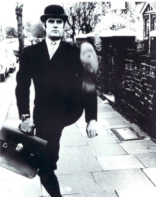 John Cleese in Monty Python's classic skit, 'Ministry of Silly Walks'. [PNG Merlin Archive]
