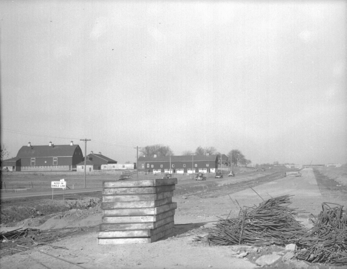 Highway 427, looking n. from n. of Bloor St. W., during construction, showing T. Eaton Co. farm at left 1953