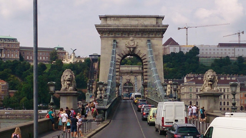 Chain bridge with stone lions