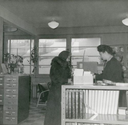 customer talking to Golden Mile branch library staff in about 1956