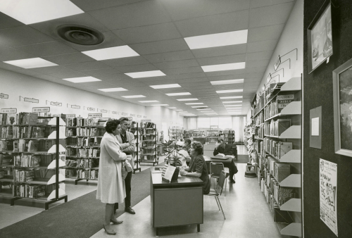 customers talking to staff in Eglinton Square branch around 1971