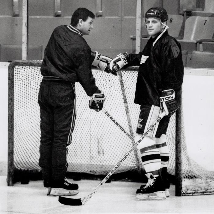 Hockey player Brett Hull practicing near the goal