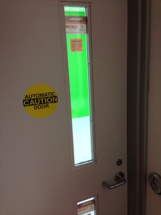 Door to green screen