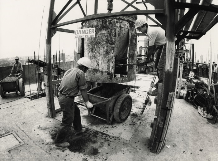 Workmen pouring bucket of concrete on CN Tower slip form Toronto Star August 21 1973