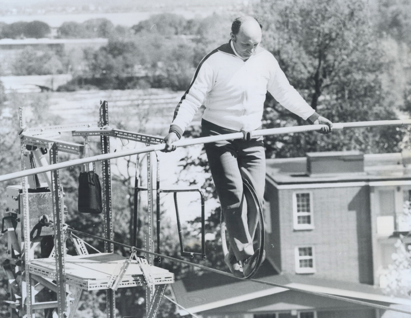 Henri (Henry) Rechatin riding a metal wheel on a tightrope on May 23, 1976 over the Falls
