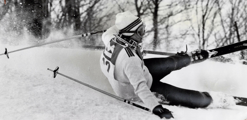 Skier Betsy Clifford falling during a ski race