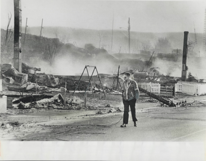 Ruined small town with man walking through
