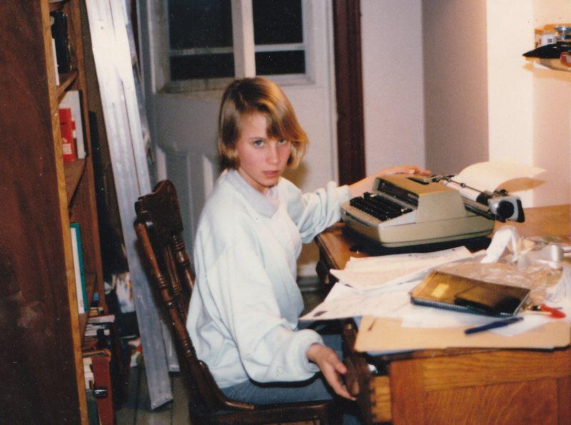 Teen Emily at typewriter