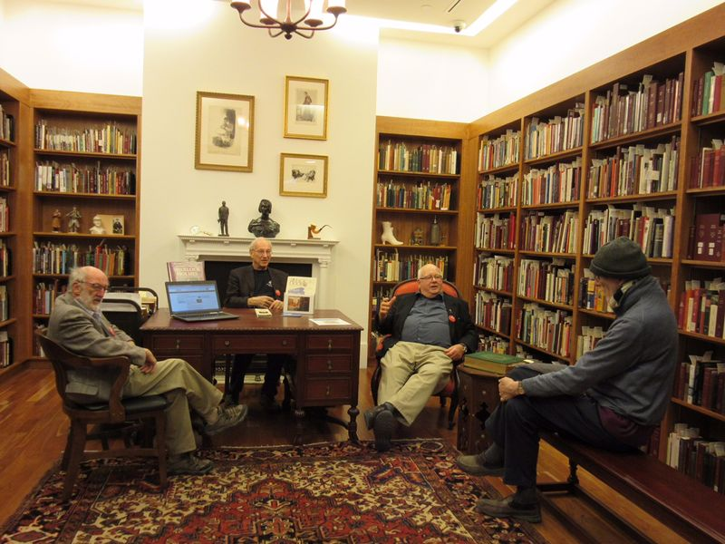 Friends of the Arthur Conan Doyle Collection chatting with a library visitor