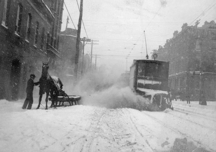 1900s circa Queen Street East between Church and Sherbourne showing sleigh and snow plow  electric tram