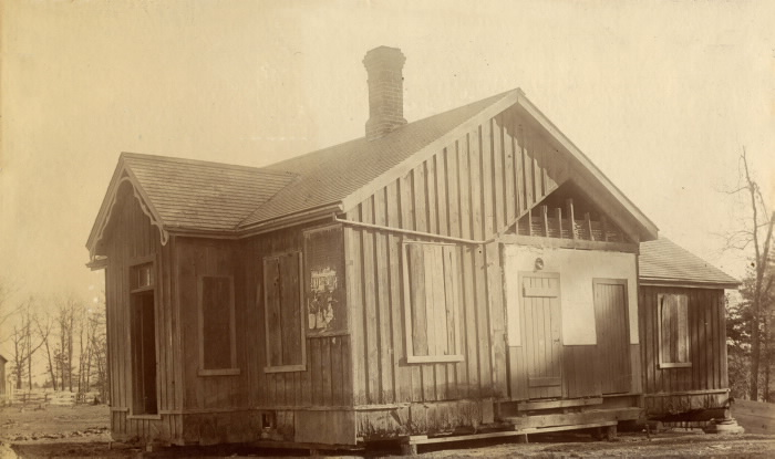 Toll Gate, Dundas Street west, north side, at St. Clair Avenue West, showing toll house, Toronto, Ont. b3-27a