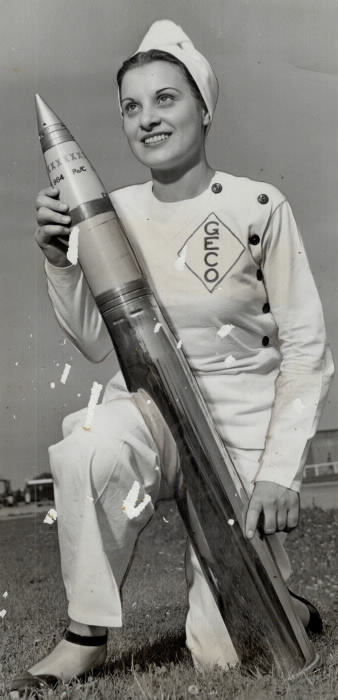 1944 photo of woman with shell for gun