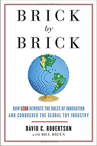 Book cover showing a globe made in lego blocks