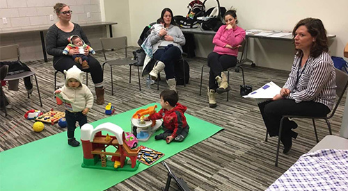 Moms and a couple of their kids meet at Brentwood Branch