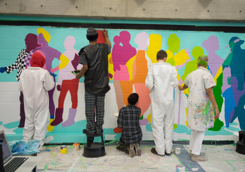 Teens Painting a wall at York Woods Branch