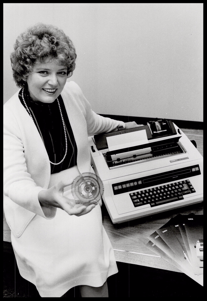 Louise Rossholds holding daisywheel from the Xerox Memorywriter
