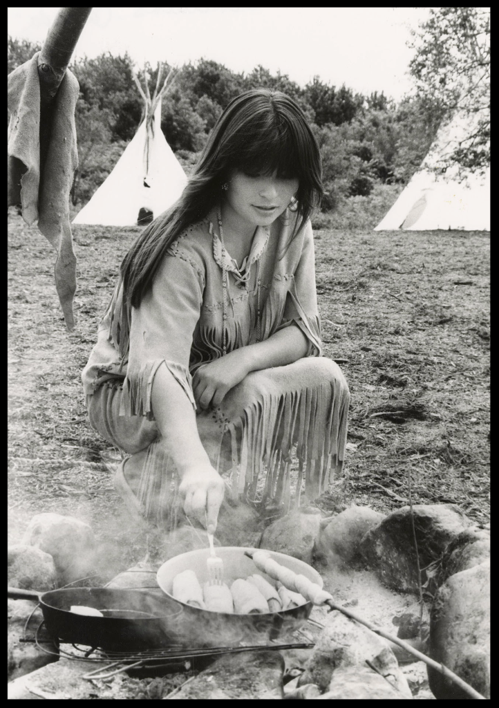 Woman cooking over fire