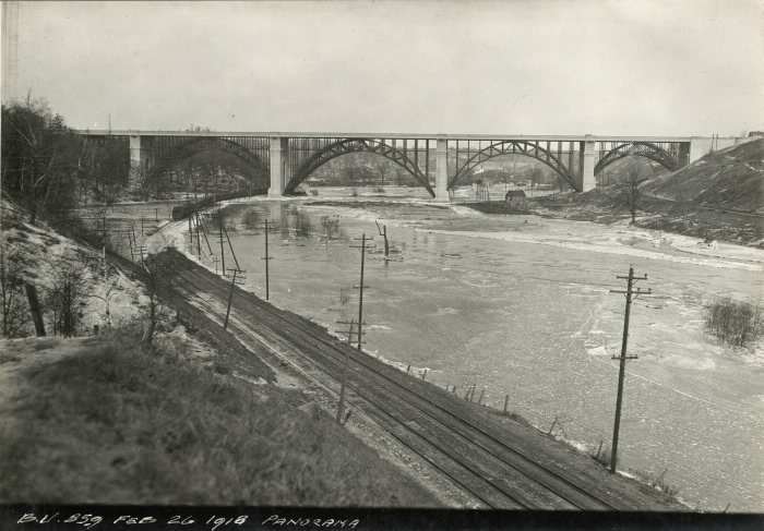 Railroad and icy river leading to profile of complete viaduct