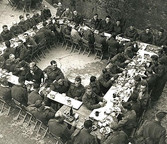 Members of the Seaforth Highlanders sit down for their Christmas dinner ortona-3
