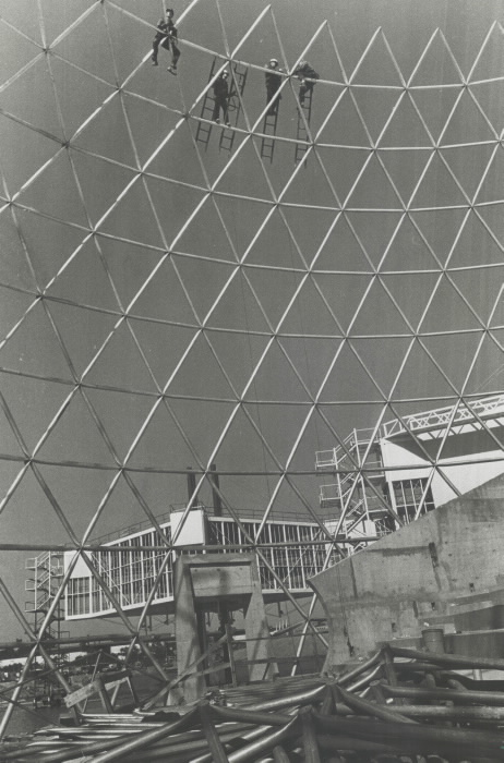 1970 photo Workmen hang high in the lattice work of geodesic aluminum dome they are building to roof the theatre at Ontario Place