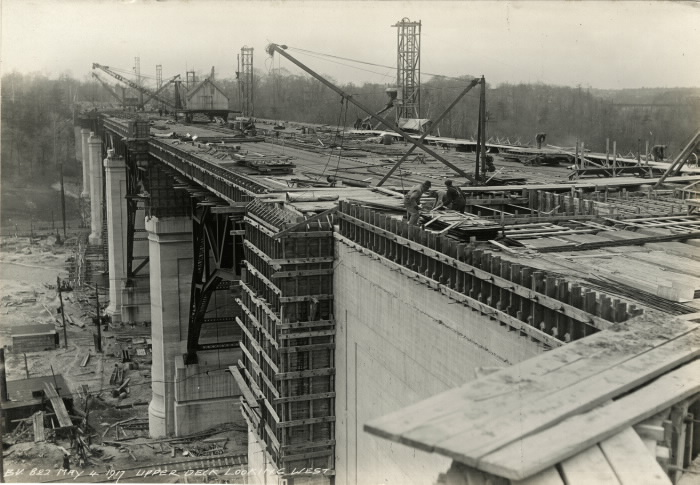 An wide view of an almost completed bridge with workers