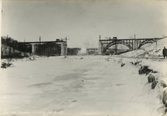 Bridge under construction with middle section missing  set in a snowy landscape