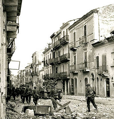 Infantry of the Edmonton Regiment supported by Sherman tanks of the Three Rivers Regiment  Ortona  Italy. December 23  1943 streets-ortona