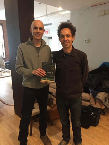 Alex Hutchinson and Malcolm Gladwell with book  Endure