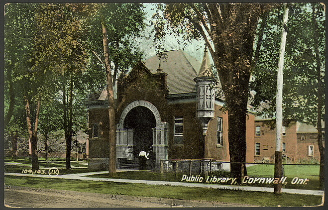 Postcard of ornate brick building among trees