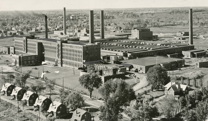 Aerial view of factories with smoke stacks
