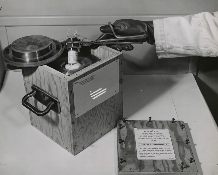 Pulling a small amount of radioactive material from a special transportation case