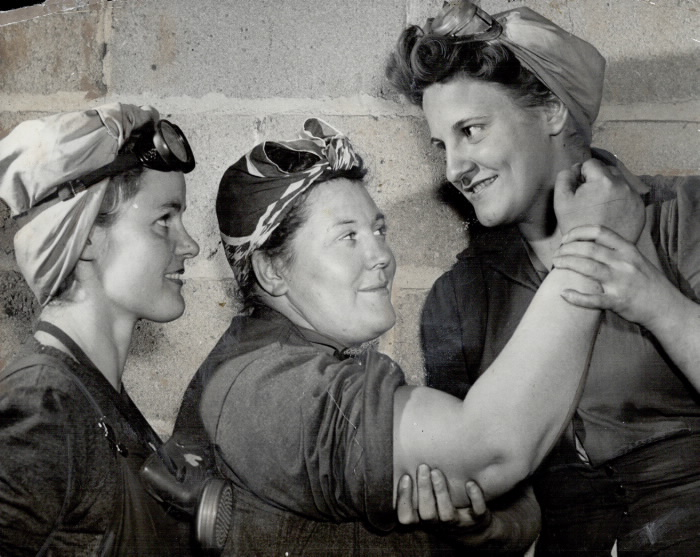 1943 vintage photo That's all muscle on the arm of Mrs. Robert Wright; 235-pound sandblaster at John Inglis Co. in Toronto.