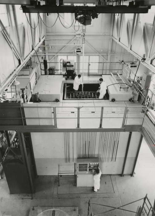 Overhead view of laboratory workers in a facility with large machines