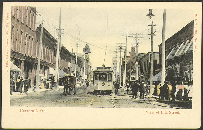 Postcard of busy street with street car