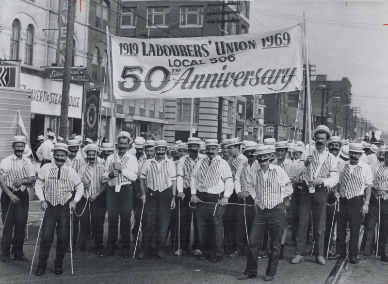 Toronto laborers celebrating their union's 75th anniversary paraded in 1890s costumes in the 1969 Labor Day march to the CNE