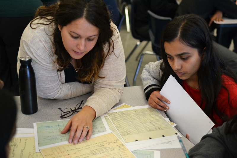 Laura  TPL librarian  works with a student