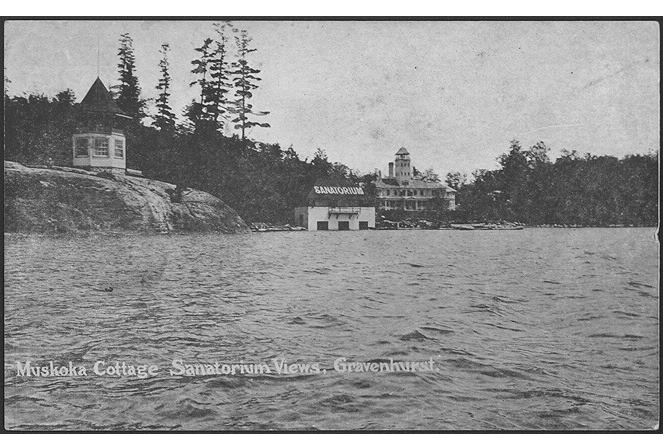 Postcard of waterfront and three structures including one that has sanatorium written on tis roof