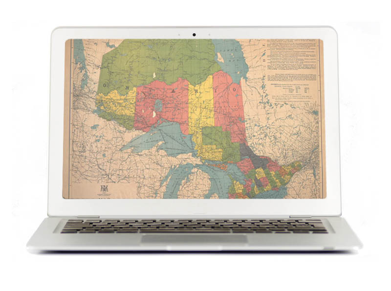 Laptop with vintage image Ontario map on its entire screen