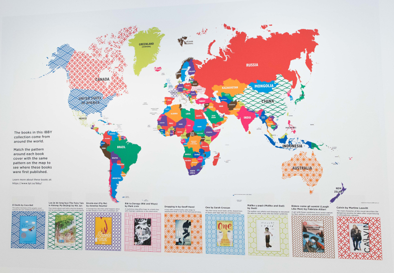 Giant colour coded world map with some countries filled in with a pattern associated with a book indicated in a legend under the map