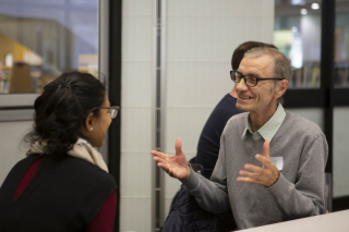 A member from Department of Imaginary Affairs talking to a program participant.