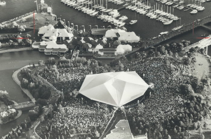 Aerial view of large crowd in outdoor area near tents