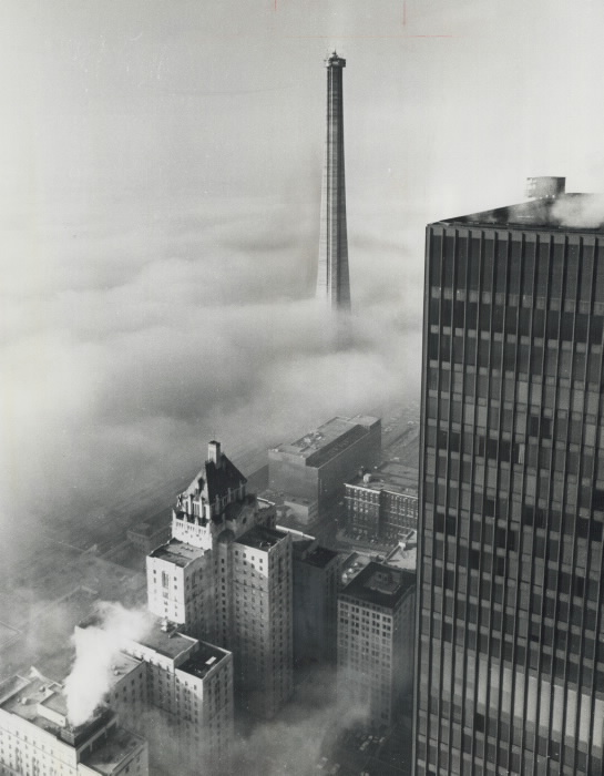 Foggy aerial view of tower partially constructed