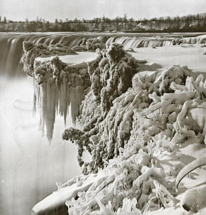 Frozen tree in front of water falls