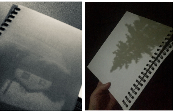 Two side by side photos of sketch pads showing grey outlines of house and tree