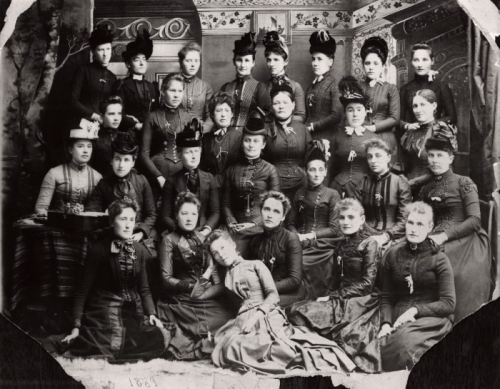 Black and white portrait of 26 women seated and standing