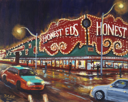 A car and taxi drive passed the brightly illuminated signage of Honest Ed's department store at night. The road appears wet and reflects the signage and street lights.