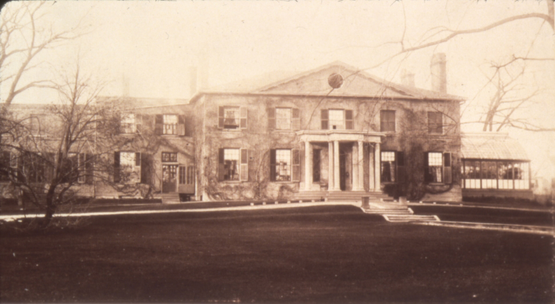 Vintage photo of large manor with large front yard