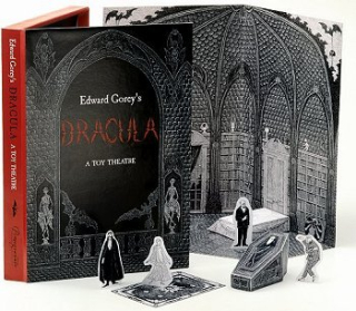 Paper cutouts of characters and set pieces feature Edward Gorey's distinctive pen-and-ink drawings.